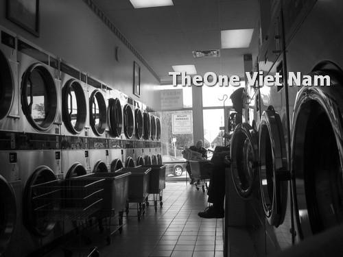 cách bố trí máy giặt là ủi trong xưởng giặt là